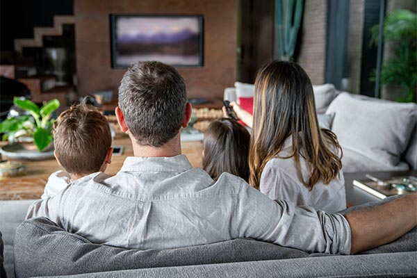 Family Watching Nature Video On Television
